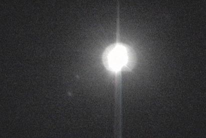 These are 2 video frames I shot from 2001 ufodays. They are consecutive frames- only 1/30 sec. apart